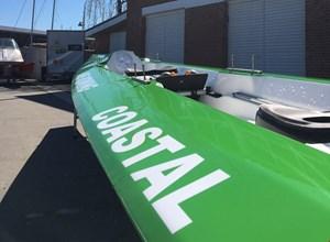 Vi låner denne fine grønne Coastal-båd